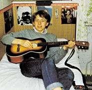 Ung Ulf Lundell med gitarr