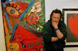 Ulf Lundell och ett av hans konstverk